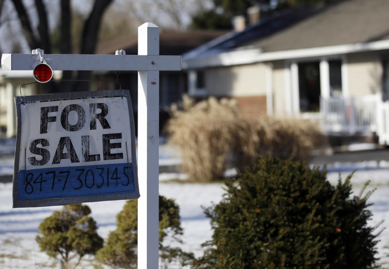 """In this  Jan. 5, 2013, photo a """"for sale"""" sign is seen outside a home in Glenview, Ill. Five of the biggest U.S. banks have cut struggling homeowners' mortgage balances by $19 billion, part of a total $45.8 billion in relief provided under a landmark settlement over foreclosure abuses. (AP Photo/Nam Y. Huh)"""