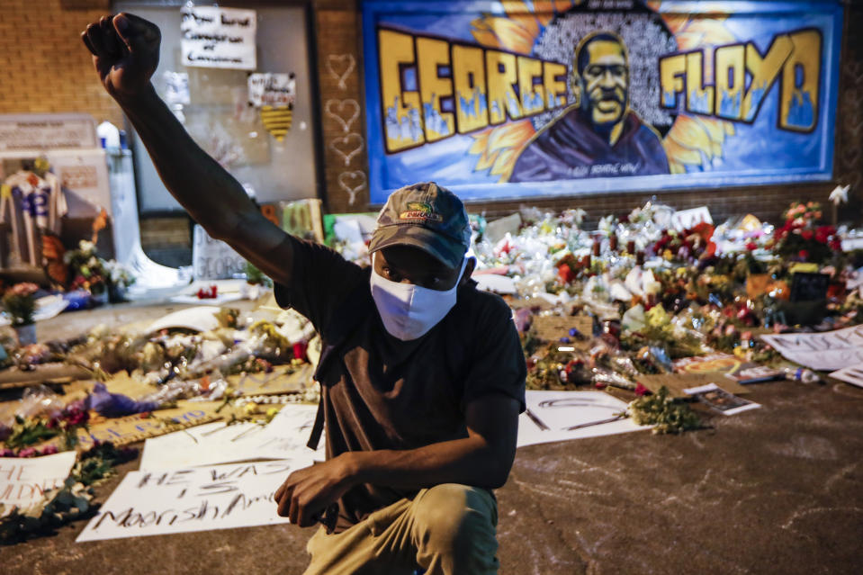 Protesters gather at a memorial for George Floyd where he died outside Cup Foods on East 38th Street and Chicago Avenue, Monday, June 1, 2020, in Minneapolis. Protests continued following the death of Floyd, who died after being restrained by Minneapolis police officers on May 25. (AP Photo/John Minchillo)