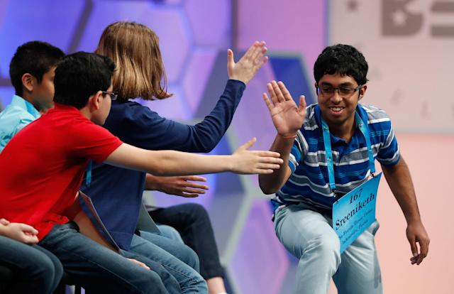<p>Sreeniketh Vogoti, 14, from Saint Johns, Fla., right, celebrates with his fellow spellers after spelling his word correctly during the 90th Scripps National Spelling Bee, Thursday, June 1, 2017, in Oxon Hill, Md. (AP Photo/Alex Brandon) </p>