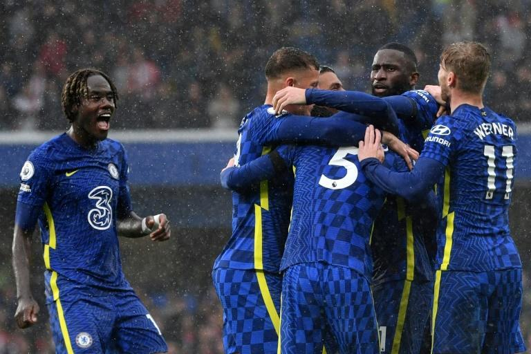 Chelsea celebrate their third goal in a 3-1 win against Southampton (AFP/JUSTIN TALLIS)