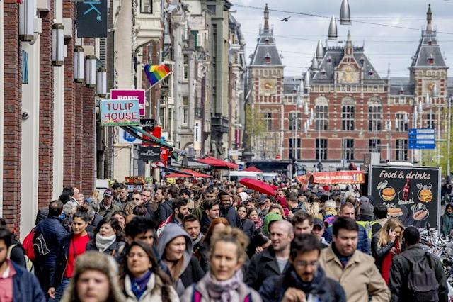 Every year the flow of sightseers flocking to Amsterdam's 165 canals grows by some five percent as the result of an impressive marketing campaign (AFP Photo/Robin Utrecht)