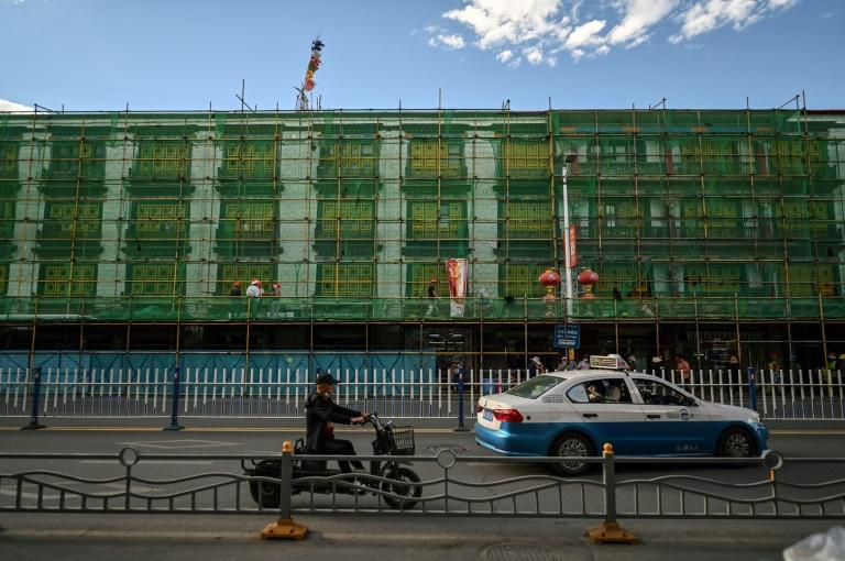 China's government says development is the antidote to discontent in Tibet, where many people still revere the Dalai Lama -- the region's spiritual leader -- and resent an influx of Chinese tourists and settlers