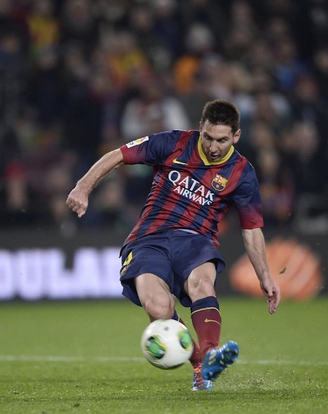 FC Barcelona's Lionel Messi, from Argentina, kicks the ball to score against Getafe during a Copa del Rey soccer match at the Camp Nou stadium in Barcelona, Spain, Wednesday, Jan. 8, 2014. (AP Photo/Manu Fernandez)