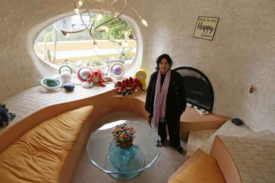 """Attorney Angela Alioto looks over a sunken room called """"The Happy Place,"""" inside the Flintstone House in Hillsborough, Calif. Image: AAP"""