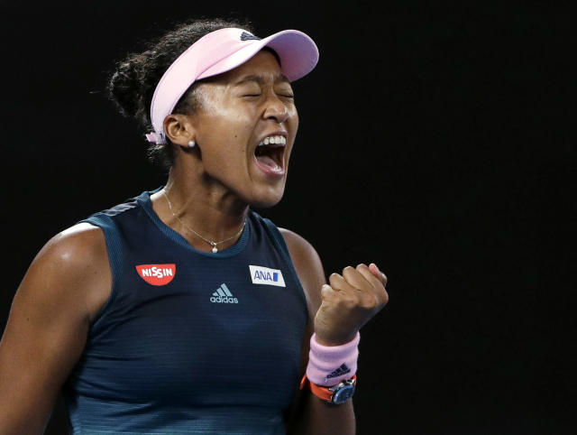 Japan's Naomi Osaka reacts after winning the first set against Petra Kvitova of the Czech Republic during the women's singles final at the Australian Open tennis championships in Melbourne, Australia, Saturday, Jan. 26, 2019. (AP Photo/Mark Schiefelbein)