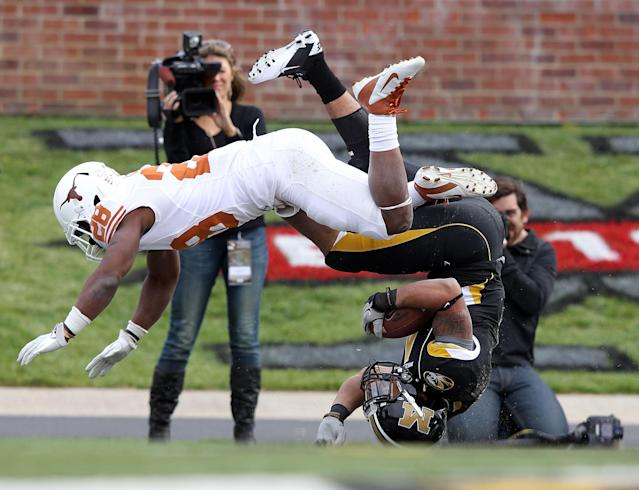 COLUMBIA, MO - NOVEMBER 12: Kendial Lawrence #4 of the Missouri Tigers lands upside-down while carrying the ball into the endzone for a touchdown as Quandre Diggs #28 of the Texas Longhorns defends during the game on November 12, 2011 at Faurot Field/Memorial Stadium in Columbia, Missouri. (Photo by Jamie Squire/Getty Images)
