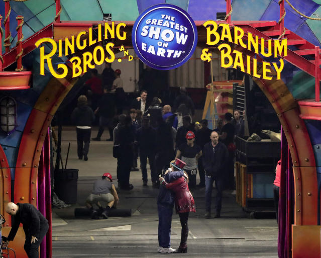 <p>Ringmaster Kristen Michelle Wilson, right, hugs a member of the crew after the red unit's final performance, Sunday, May 7, 2017, in Providence, R.I. For the performers who travel with the Ringling Bros. and Barnum & Bailey Circus, its demise means the end of a unique way of life for hundreds of performers and crew members. (Photo: Julie Jacobson/AP) </p>