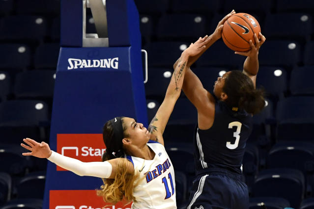 DePaul guard Sonya Morris (11) blocks a shot by Connecticut forward Megan Walker (3) during the first half of an NCAA college basketball game on Monday, Dec. 16, 2019. in Chicago, Ill. (AP Photo/Matt Marton)