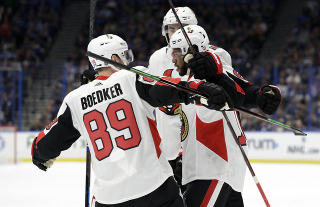 Ottawa Senators left wing Anthony Duclair, right, celebrates his goal against the Tampa Bay Lightning with left wing Mikkel Boedker, left, during the first period of an NHL hockey game Saturday, March 2, 2019, in Tampa, Fla. (AP Photo/Chris O'Meara)