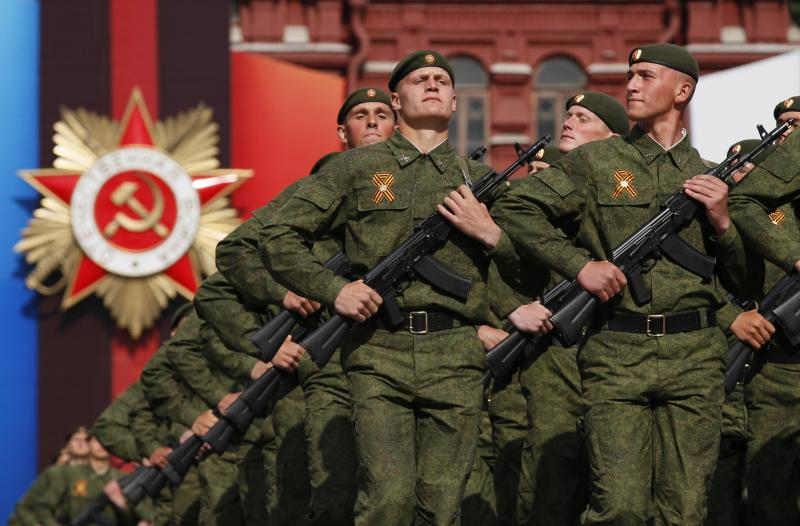 Russian marines march along Red Square during the Victory Day military parade in Moscow. Russia, on Monday, May 9, 2011. Tens of thousands of granite-faced soldiers marched in lockstep across Red Square Monday in Russia's annual Victory Day display of military might, while President Dmitry Medvedev said the country is committed to peace and global stability. The parade, marking the surrender of Nazi Germany in World War II, is the centerpiece of Russia's most solemn secular holiday, both commemorating the Soviet Union's enormous sacrifices in the war and asserting the potency of its modern military. (AP Photo/Ivan Sekretarev)