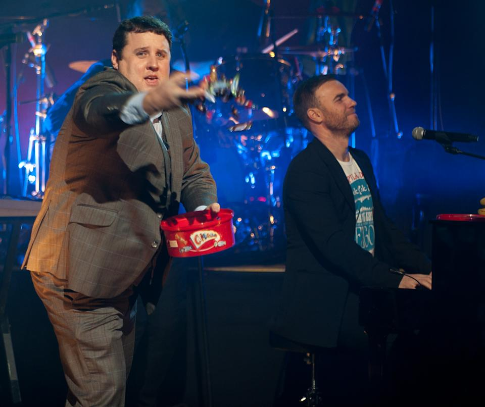 """LIVERPOOL, UNITED KINGDOM - DECEMBER 19:  ***EXCLUSIVE ACCESS: PREMIUM RATES APPLY*** Peter Kay and Gary Barlow join Coldplay to perform at charity Crisis' """"Hidden Gig"""" at the Royal Court Theatre on December 19, 2010 in Liverpool, England. (Photo by Nick Pickles/WireImage)"""