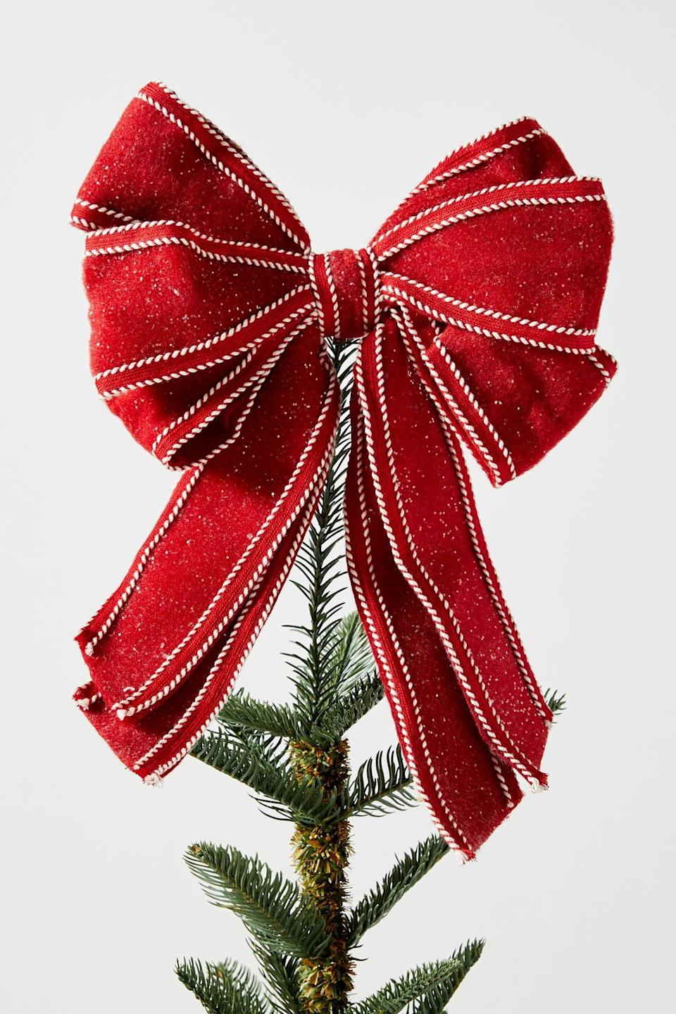 """<p>Make your tree look like a freshly wrapped present with the <a href=""""https://www.popsugar.com/buy/Red-Bow-Tree-Topper-490536?p_name=Red%20Bow%20Tree%20Topper&retailer=anthropologie.com&pid=490536&price=20&evar1=casa%3Aus&evar9=46615300&evar98=https%3A%2F%2Fwww.popsugar.com%2Fhome%2Fphoto-gallery%2F46615300%2Fimage%2F46615407%2FRed-Bow-Tree-Topper&list1=shopping%2Canthropologie%2Choliday%2Cchristmas%2Cchristmas%20decorations%2Choliday%20decor%2Chome%20shopping&prop13=mobile&pdata=1"""" rel=""""nofollow noopener"""" class=""""link rapid-noclick-resp"""" target=""""_blank"""" data-ylk=""""slk:Red Bow Tree Topper"""">Red Bow Tree Topper</a> ($20).</p>"""