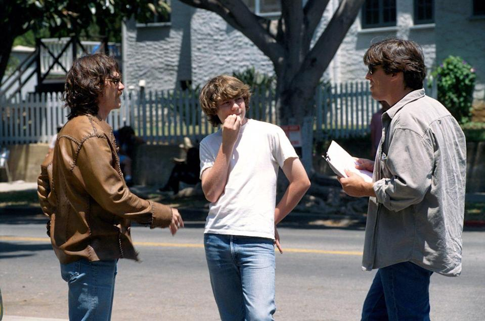 """Billy Crudup, Patrick Fugit, and Cameron Crowe on the set of """"Almost Famous"""" - Credit: ©DreamWorks/courtesy of The Everett Collection"""