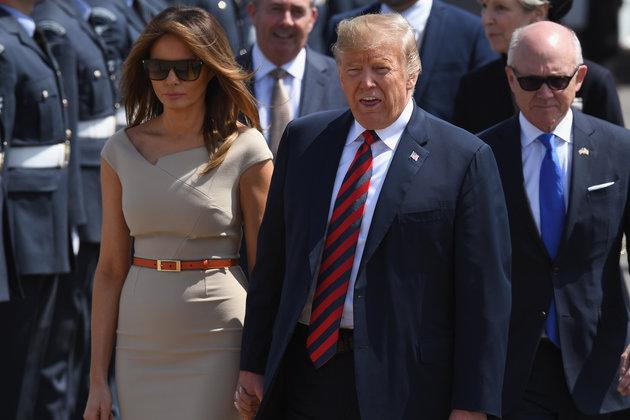 The US presidentand first lady arrive at Stansted Airport.