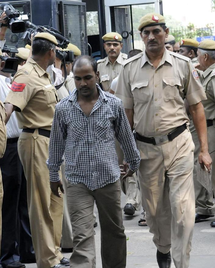 Indian police escort Mukesh Singh -- one of four men condemned to death for the murder and gang-rape of an student in new Delhi -- after his 2013 trial at the High Court in New Delhi (AFP Photo/-)