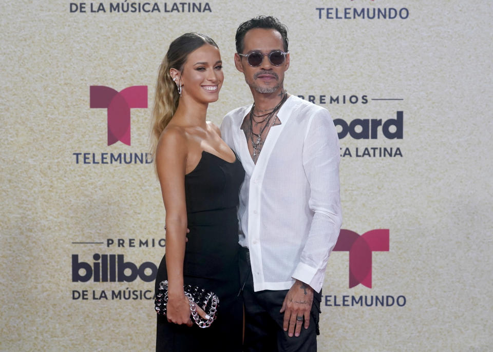 Marc Anthony, right, arrives at the Billboard Latin Music Awards on Thursday, Sept. 23, 2021, at the Watsco Center in Coral Gables, Fla. (AP Photo/Marta Lavandier)