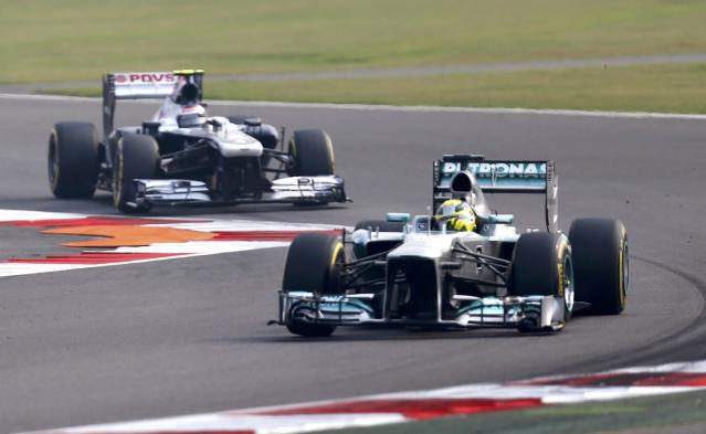 Mercedes Formula One driver Nico Rosberg of Germany (front) and Williams Formula One driver Valtteri Bottas of Finland drive during the qualifying session of the Indian F1 Grand Prix at the Buddh International Circuit in Greater Noida, on the outskirts of New Delhi, October 26, 2013. REUTERS/Ahmad Masood (INDIA - Tags: SPORT MOTORSPORT F1)