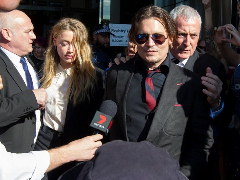 Amber and Johnny outside a QLD court. Source: Splash