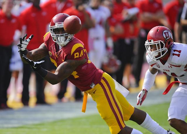 Southern California wide receiver Darreus Rogers (84) gets by Utah defensive back Davion Orphey (11) for a reception during the first half of an NCAA college football game, Saturday, Oct. 26, 2013, in Los Angeles. (AP Photo/Gus Ruelas)