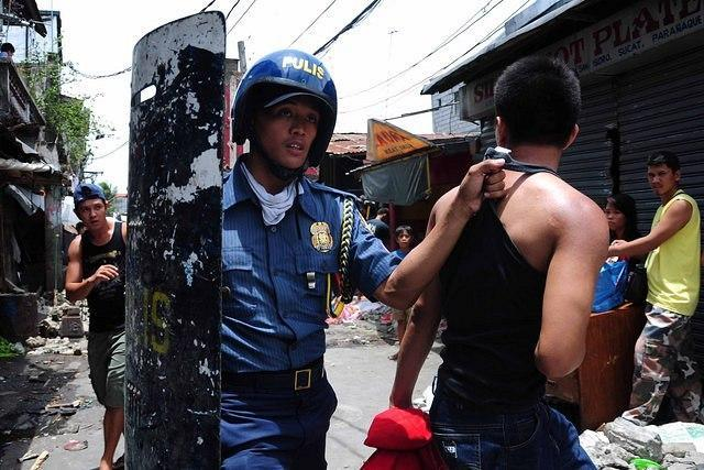 MANILA, Philippines - Random arrests were made during the demolition of the Silverio compound in Paranaque City on 23 April 2012. 14 was injured, and 1 was confirmed dead as a result of the bloody dispersal. KADAMAY says the demolition will give way to construction of Henry Sy's condominium under the SMDC. (George Calvelo/NPPA Images)
