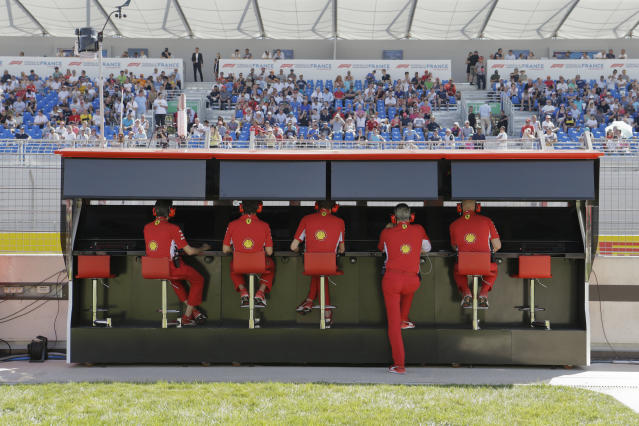 Ferrari team members watch monitors during the second free practice at the Paul Ricard racetrack, in Le Castellet, southern France, Friday, June 22, 2018. The Formula one race will be held on Sunday. (AP Photo/Claude Paris)