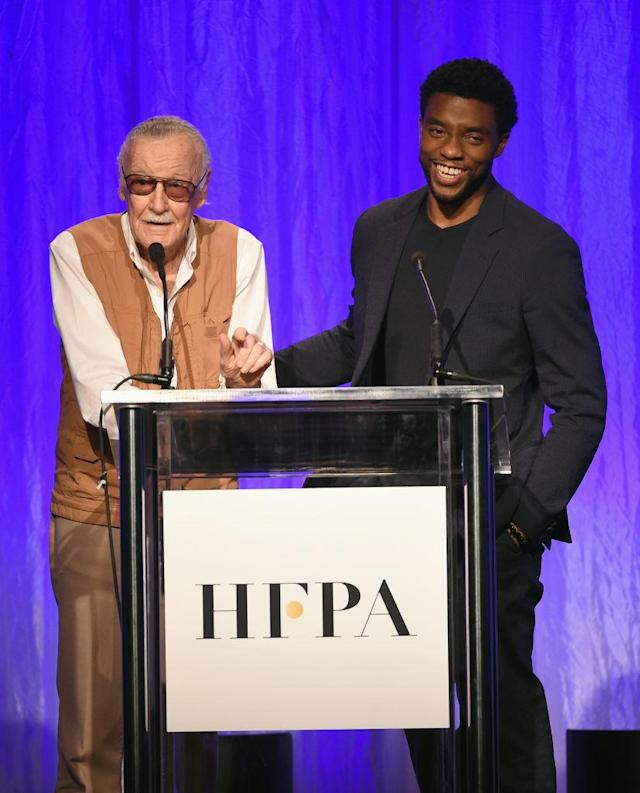 Stan Lee and Chadwick Boseman, who plays the character Black Panther, which Lee created, appear onstage at the Hollywood Foreign Press Association's Grants Banquet on Aug. 2 last year in L.A. (Photo by Kevin Winter/Getty Images)