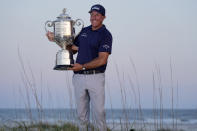 Phil Mickelson holds the Wanamaker Trophy after winning the PGA Championship golf tournament on the Ocean Course, Sunday, May 23, 2021, in Kiawah Island, S.C. (AP Photo/David J. Phillip)