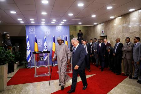 Israeli Prime Minister Benjamin Netanyahu and Chadian President Idriss Deby leave after delivering joint statements in Jerusalem November 25, 2018. REUTERS/Ronen Zvulun