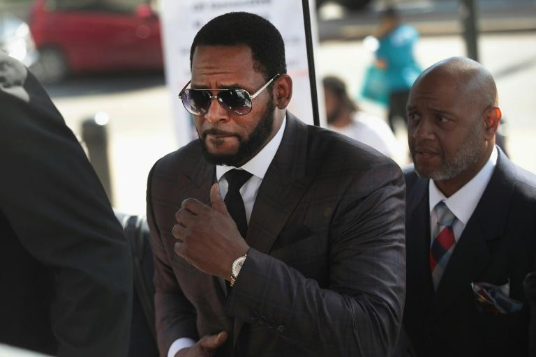R&B singer R. Kelly, pictured arriving at the Leighton Criminal Courts Building for a hearing in Chicago, Illinois in 2019, faces life in prison after he was found guilty of racketeering and sex abuse charges in a New York court (AFP/SCOTT OLSON)
