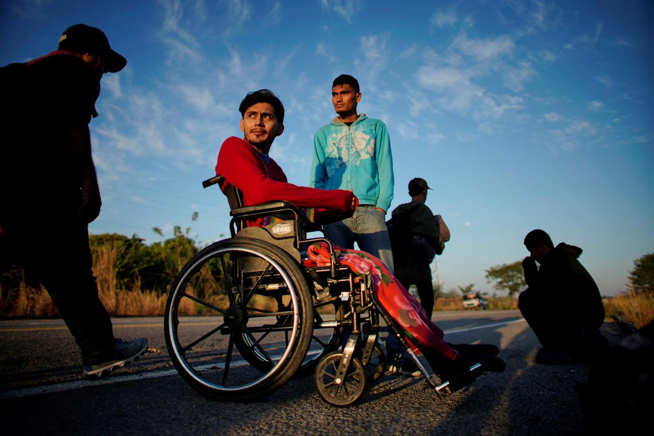 Paraplegic migrant Jose Serrano, from Honduras, rests beside his friend Jerian, during their journey towards the United States, in Niltepec, Mexico, January 22, 2019. REUTERS/Alexandre Meneghini      TPX IMAGES OF THE DAY
