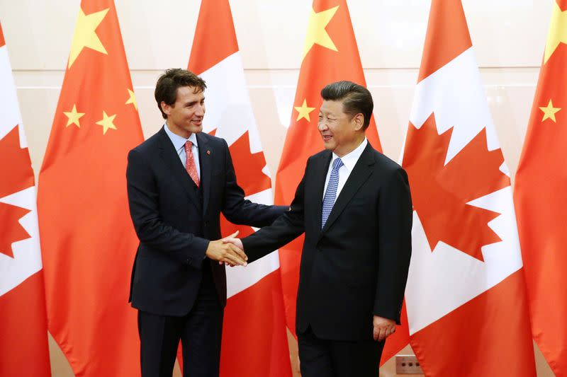 FILE PHOTO: Chinese President Xi Jinping shakes hands with Canadian Prime Minister Trudeau ahead of their meeting at the Diaoyutai State Guesthouse in Beijing