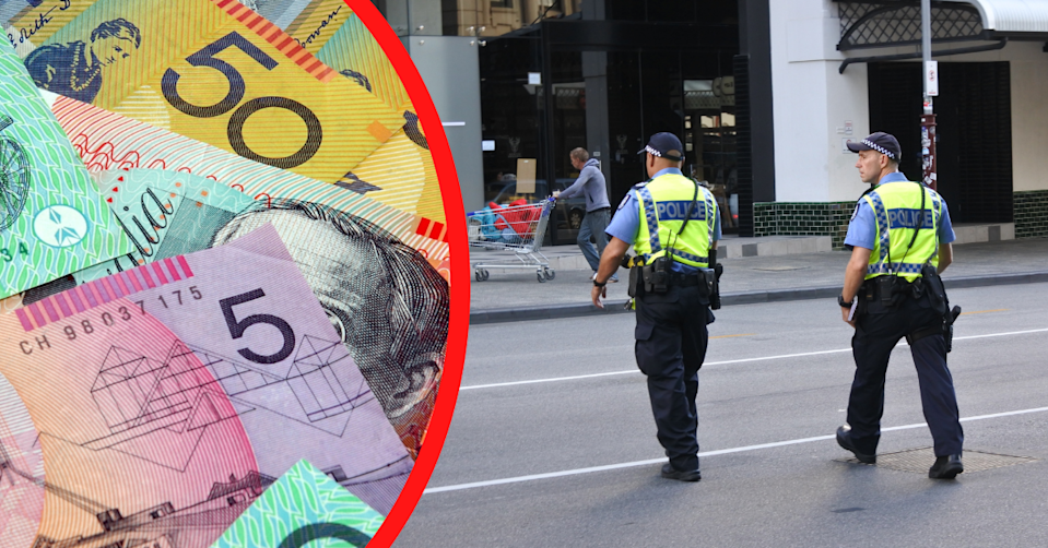 Australian money notes staked on top of each other and two Australian police officers cross a road.