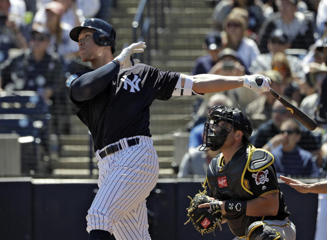 New York Yankees' Aaron Judge follows the flight of his RBI double off Pittsburgh Pirates starting pitcher Joe Musgrove during the first inning of a spring training baseball game Thursday, March 15, 2018, in Tampa, Fla. Yankees' Brett Gardner scored on the hit. Catching for the Pirates is Francisco Cervelli. (AP Photo/Chris O'Meara)
