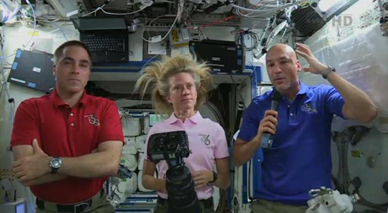 In this image from video made available by NASA, Italian astronaut Luca Parmitano, right, describes the water in his helmet on the Tuesday, July 16, 2013 spacewalk with U.S. astronaut Chris Cassidy, right, during a news conference with U.S. astronaut Karen Nyberg on the International Space Station on Thursday, July 13, 2013. Parmitano, Italy's first and only spacewalker, could not hear or speak by the time he re-entered the space station on Tuesday, 1½ hours after stepping out. He also said he had difficulty seeing because of the big globs of water in his helmet and elsewhere in his suit. (AP Photo/NASA)