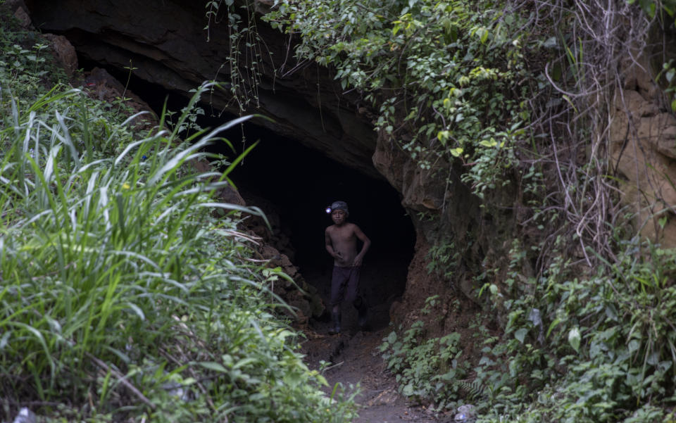 """Andres Gomez, 11, exits the amber mine where he works near the community of Jotolchen II in Chiapas state, Mexico, Thursday, Sept. 10, 2020. Since the start of the new coronavirus pandemic lockdown, Andres works in the mine hoping to find a piece of amber for which a middleman might pay him $1 to $5, but what he really wants is """"To learn to read and write,"""" he said. (AP Photo/Eduardo Verdugo)"""