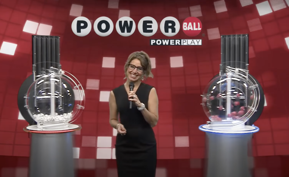 The Powerball numbers are seen being drawn.