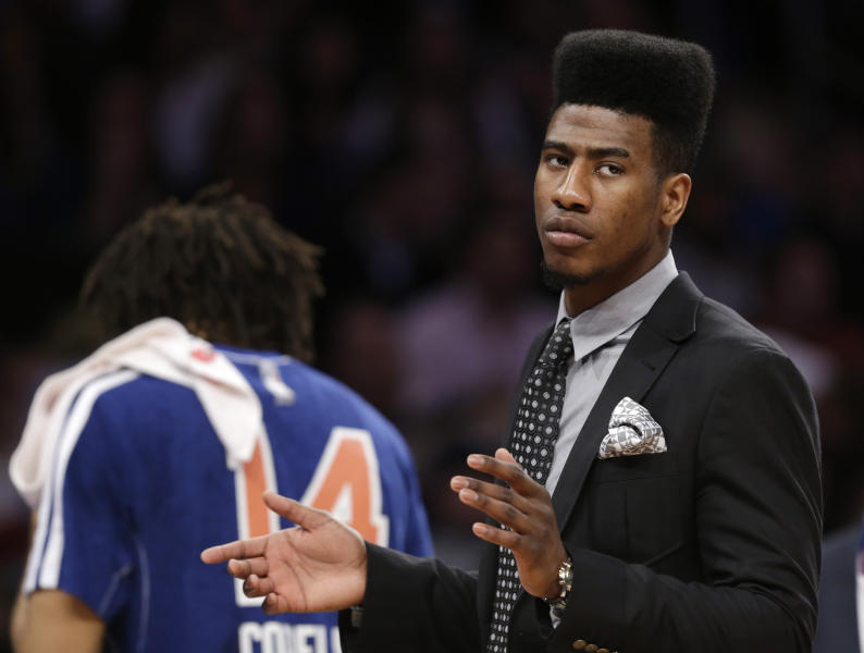 New York Knicks guard Iman Shumpert, who had offseason surgery to correct a torn left ACL, applauds as the Knicks defeated the New Orleans Hornets in an NBA basketball game at Madison Square Garden in New York, Sunday, Jan. 13, 2013. (AP Photo/Kathy Willens)