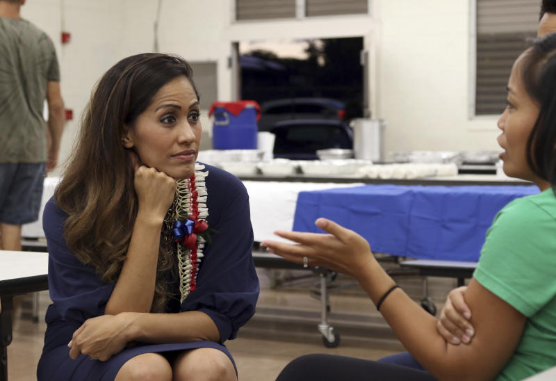 In this Oct. 17, 2018 photo, Republican candidate for Hawaii governor Andria Tupola speaks to a woman at a campaign event in Honolulu. (AP Photo/Audrey McAvoy)