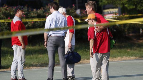 PHOTO: Republican Senator from Arizona Jeff Flake hugs another member of the Republican congressional baseball team following a shooting in Alexandria, Va., June 14, 2017. (Shawn Thew/EPA)