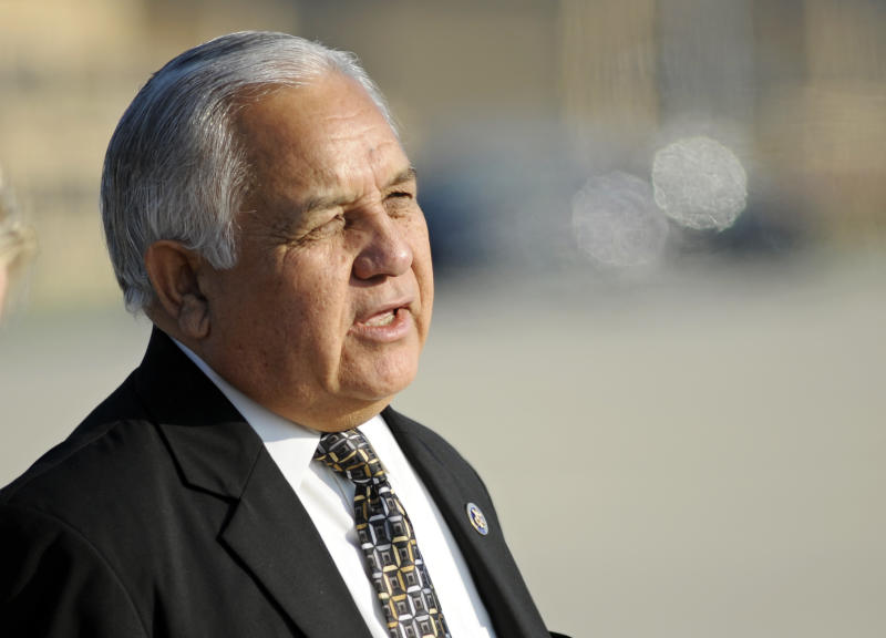 FILE - Rep. Silvestre Reyes, D-Texas prepares to board  Air Force One, ahead of President Barack Obama, at Andrews Air Force Base, Md., in this Aug. 31, 2010 file photo. In a major upset, longtime U.S. Rep. Silvestre Reyes has lost the race for the Democratic nomination to retain his congressional seat in far West Texas Tuesday May 29, 2012. The 67-year-old Reyes was first elected to Congress in 1996.  (AP Photo/Cliff Owen)