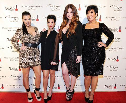 Khloe Kardashian now (second from R), with her sisters, Kim (L) and Kourtney (second from L) and her mother Kris Jenner, (R). Creidt: Getty Images