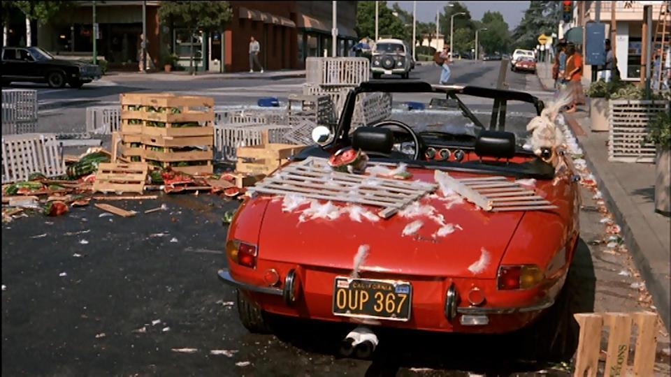 """<p>Wayne happens across some busy workmen in the street: some are carrying boxes over watermelons across the street, others boxes of chickens – and two men and repeatedly crossing the road with a large plate-glass window. """"You've got to think this is going to pay off later,"""" winks Wayne, and sure enough, later in the movie, the street is wrecked by car. (Credit: Paramount Pictures) </p>"""