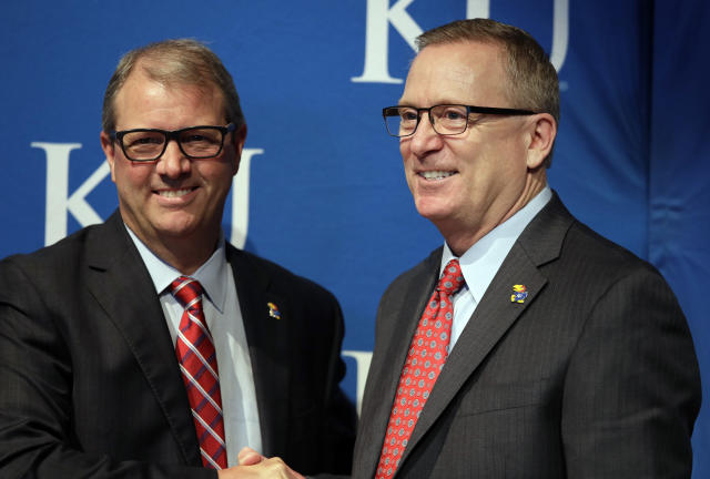 Kansas Chancellor Douglas Girod, left, introduces new athletic director Jeff Long, right, during a news conference in Lawrence, Kan., Wednesday, July 11, 2018. (AP Photo/Orlin Wagner)
