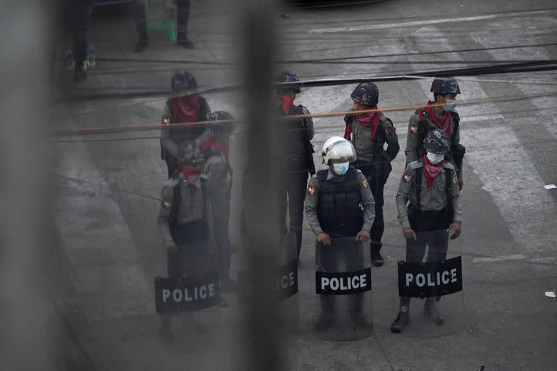 Police stand after they seized Sanchaung district in search of anti-coup demonstrators in Yangon
