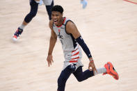Washington Wizards forward Rui Hachimura (8) reacts after he made a three-point basket during the second half of Game 4 in a first-round NBA basketball playoff series against the Philadelphia 76ers, Monday, May 31, 2021, in Washington. (AP Photo/Nick Wass)