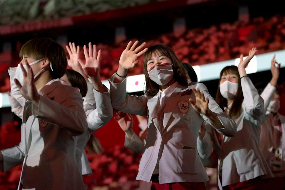 Athletes from Team Japan enter Tokyo's Olympic Stadium during the opening ceremony.