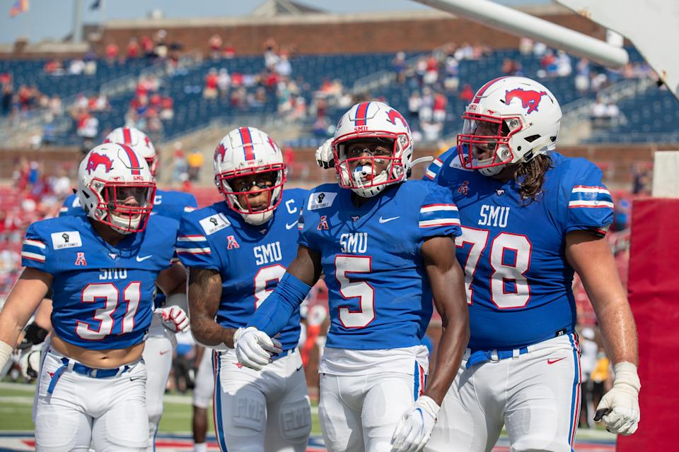 DALLAS, TX - OCTOBER 03: SMU Mustangs wide receiver Danny Gray (#5) and teammates including running back Tyler Lavine (#31), wide receiver Reggie Roberson, Jr. (#8), and offensive lineman Beau Morris (#78) celebrate after Gray scored a touchdown during the college football game between the SMU Mustangs and Memphis Tigers on October 3, 2020, at Gerald J. Ford Stadium in Dallas, TX.  (Photo by Matthew Visinsky/Icon Sportswire via Getty Images)