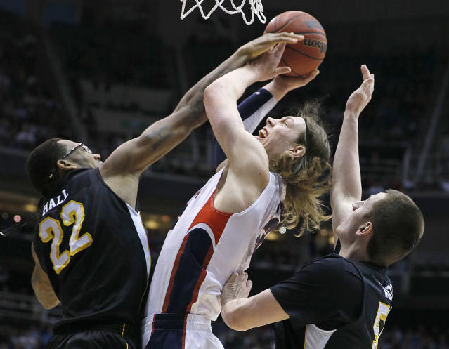 Gonzaga's Kelly Olynyk, center, is sandwiched between Wichita State's Carl Hall, left and Demetric Willimas during the first half of a third-round game in the NCAA men's college basketball tournament in Salt Lake City on Saturday, March 23, 2013. (AP Photo/George Frey)