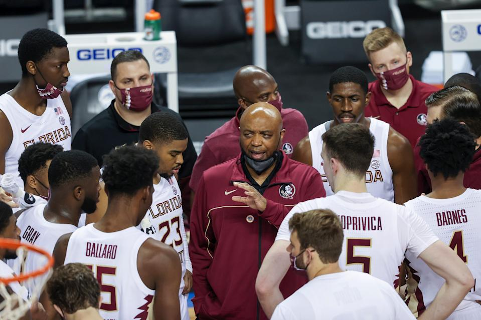 Florida State Seminoles head coach Leonard Hamilton talks to his team during a timeout as they play the North Carolina Tar Heels during the first half in the 2021 ACC tournament semifinal game at Greensboro Coliseum.