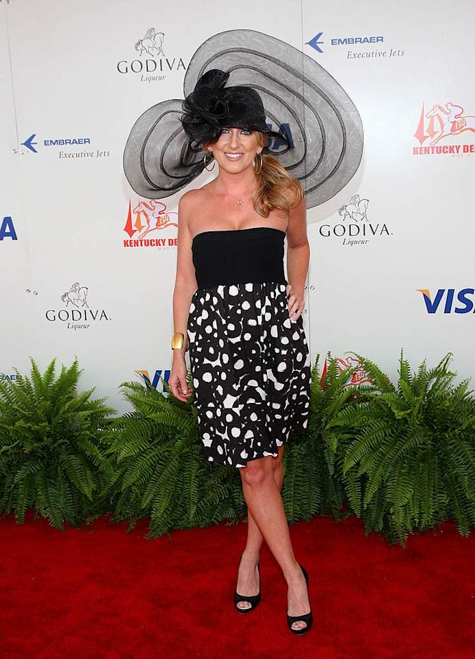 """Hopefully Lee Ann Womack will do the unfortunate people sitting behind her a favor by flying off into the sunset courtesy of her helicopter-like hat. Jason Kempin<a href=""""http://www.wireimage.com"""" target=""""new"""">WireImage.com</a> - May 3, 2008"""